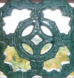 A Chinese tile, part of the balustrade of the bell tower of the main house. Photograph by Melanie Hasbrook.